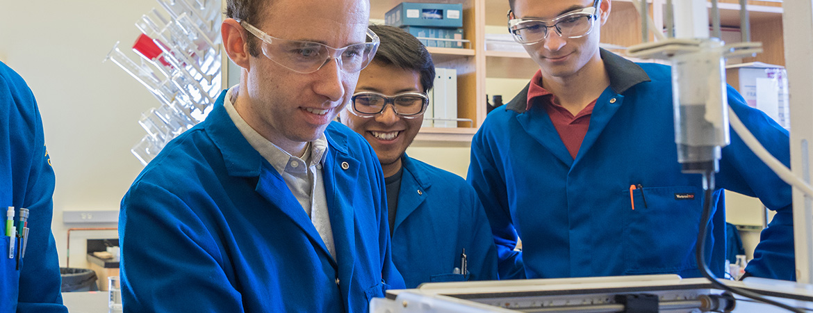 Professor Jessica Wang's researchers watch the printing of their newly synthesized materials.